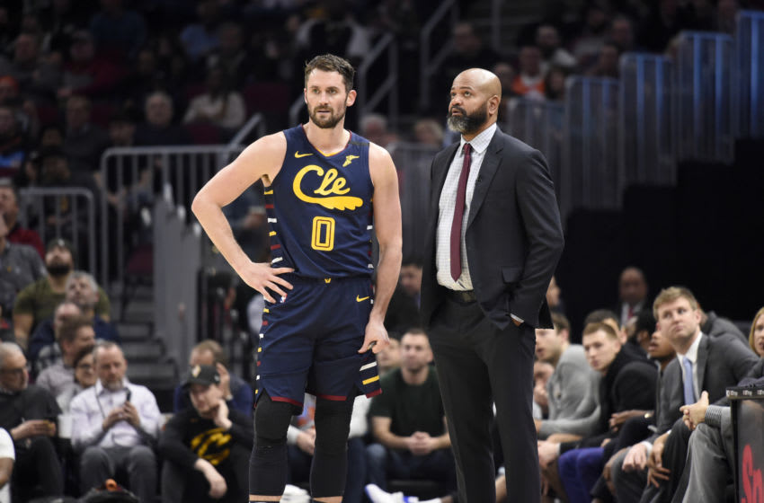 Cleveland Cavaliers big man Kevin Love (left) and Cleveland head coach J.B. Bickerstaff talk in-game. (Photo by Jason Miller/Getty Images)