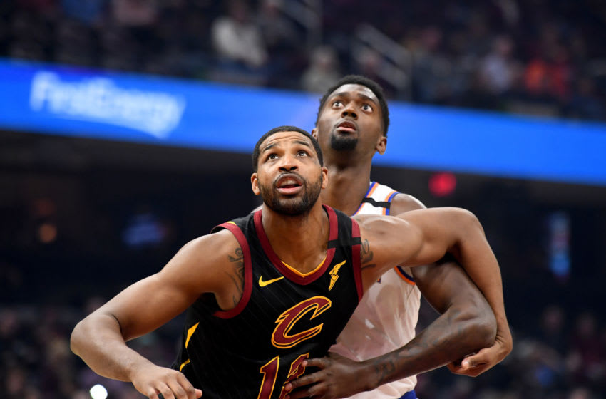 CLEVELAND, OHIO - JANUARY 20: Tristan Thompson #13 of the Cleveland Cavaliers and Bobby Portis #1 of the New York Knicks fight for a rebound during the first half at Rocket Mortgage Fieldhouse on January 20, 2020 in Cleveland, Ohio. NOTE TO USER: User expressly acknowledges and agrees that, by downloading and/or using this photograph, user is consenting to the terms and conditions of the Getty Images License Agreement. (Photo by Jason Miller/Getty Images)