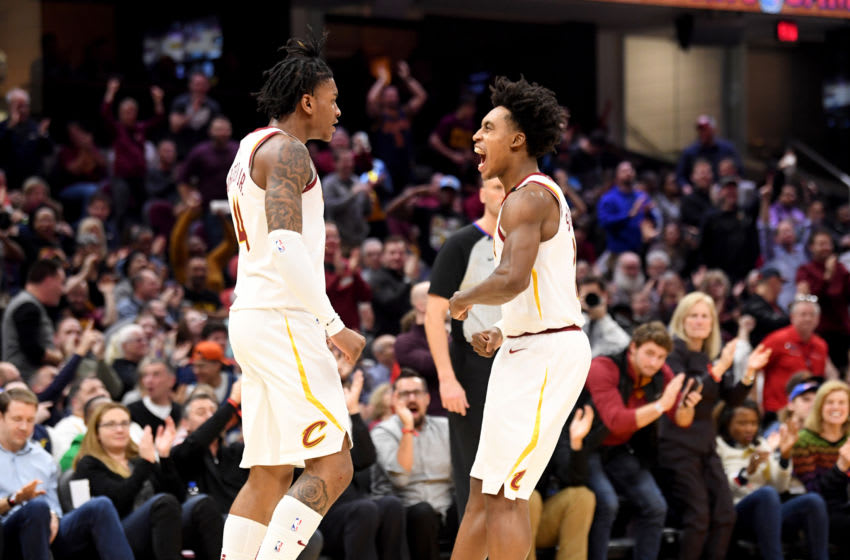 Cleveland Cavaliers wing Kevin Porter Jr. (left) and Cleveland guard Collin Sexton celebrate in-game. (Photo by Jason Miller/Getty Images)