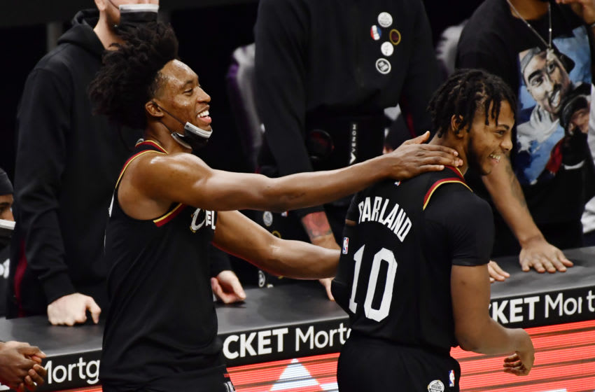 Cleveland Cavaliers guards Collin Sexton (left) and Darius Garland celebrate in-game. (Photo by Ken Blaze-USA TODAY Sports)