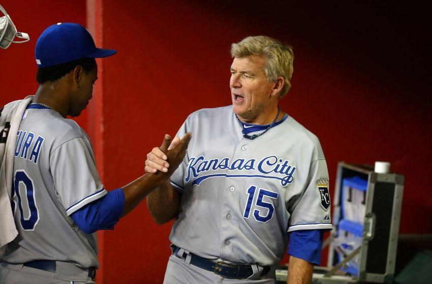 Aug 6, 2014; Phoenix, AZ, USA; Kansas City Royals pitcher Yordano Ventura (left) with first base coach Rusty Kuntz against the Arizona Diamondbacks at Chase Field. Mandatory Credit: Mark J. Rebilas-USA TODAY Sports