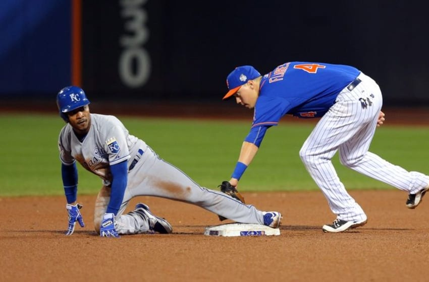 Nov 1, 2015; New York City, NY, USA; Kansas City Royals pinch runner Jarrod Dyson (1) steals second base ahead of the throw to New York Mets shortstop Wilmer Flores (4) in the 12th inning in game five of the World Series at Citi Field. Mandatory Credit: Brad Penner-USA TODAY Sports
