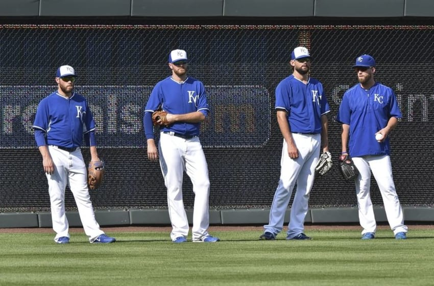 Aug 7, 2015; Kansas City, MO, USA; Kansas City Royals pitchers Greg Holland (far left), Wade Davis (left center), Luke Hochevar (right center) and Danny Duffy (far right) stand in the out field during batting practice prior to a game against the Chicago White Sox at Kauffman Stadium. Mandatory Credit: Peter G. Aiken-USA TODAY Sports