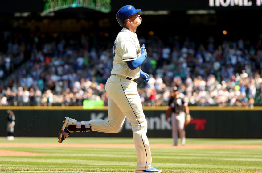 SEATTLE, WA - JULY 22: Ryon Healy #27 of the Seattle Mariners celebrates while running to home after hitting a three run home run against the Chicago White Sox in the first inning during their game at Safeco Field on July 22, 2018 in Seattle, Washington. (Photo by Abbie Parr/Getty Images)