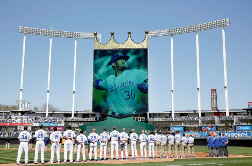 KANSAS CITY, MO - APRIL 10: Players observe a moment of silence for deceased pitcher Yordano Ventura #30 prior to the Royals 2017 home opener against the Oakland Athletics at Kauffman Stadium on April 10, 2017 in Kansas City, Missouri. (Photo by Jamie Squire/Getty Images)