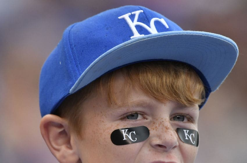 KANSAS CITY, MO - JUNE 25: A young Kansas City Royals' fan cheers for his team during a game against the Toronto Blue Jays in the eighth inning at Kauffman Stadium on June 25, 2017 in Kansas City, Missouri. (Photo by Ed Zurga/Getty Images)
