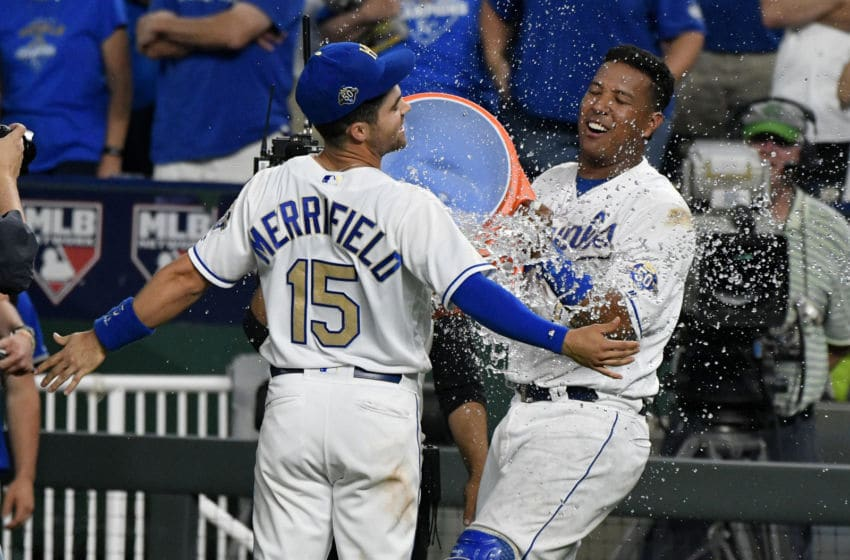 KANSAS CITY, MO - MAY 18: Whit Merrifield #15 of the Kansas City Royals is doused with water by Salvador Perez #13 as they celebrate a 5-2 won over the New York Yankees Kauffman Stadium on May 18, 2018 in Kansas City, Missouri. (Photo by Ed Zurga/Getty Images)