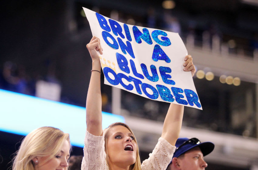 KANSAS CITY, MO - SEPTEMBER 30: A Kansas City Royals fan holds up a sign during their American League Wild Card game against the Oakland Athletics at Kauffman Stadium on September 30, 2014 in Kansas City, Missouri. (Photo by Ed Zurga/Getty Images)