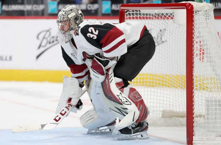 DENVER, COLORADO - MARCH 10: Antti Raanta #32 of the Arizona Coyotes tends goal against the Colorado Avalanche in the second period at Ball Arena on March 10, 2021 in Denver, Colorado. (Photo by Matthew Stockman/Getty Images)