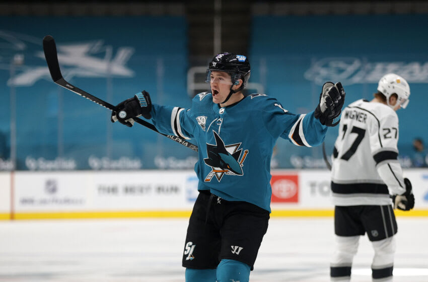 SAN JOSE, CALIFORNIA - MARCH 22: Ryan Donato #16 of the San Jose Sharks celebrates after he scored the winning goal in the thrid period of their game against the Los Angeles Kings at SAP Center on March 22, 2021 in San Jose, California. (Photo by Ezra Shaw/Getty Images)