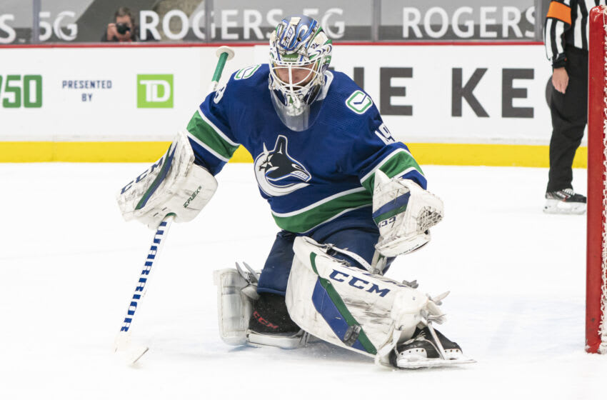 VANCOUVER, BC - APRIL 18: Goalie Braden Holtby #49 of the Vancouver Canucks makes a save during NHL hockey action at Rogers Arena against the Toronto Maple Leafs on April 17, 2021 in Vancouver, Canada. (Photo by Rich Lam/Getty Images)