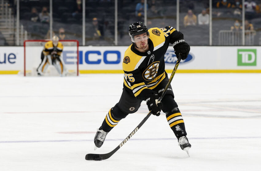 BOSTON, MASSACHUSETTS - MAY 01: Connor Clifton #75 of the Boston Bruins takes a shot against the Buffalo Sabres during the third period at TD Garden on May 01, 2021 in Boston, Massachusetts. The Bruins defeat the Sabres 6-2. (Photo by Maddie Meyer/Getty Images)
