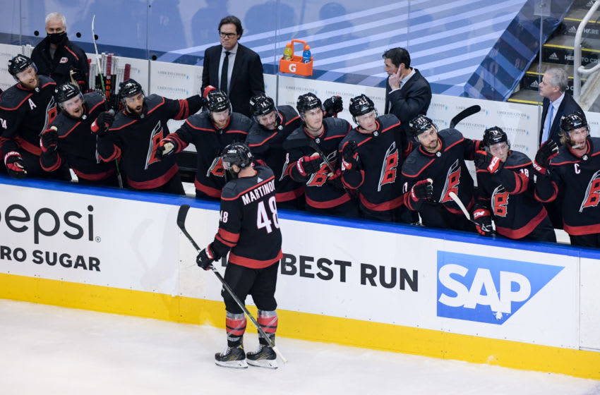 Aug 17, 2020; Toronto, Ontario, CAN; Carolina Hurricanes left wing Jordan Martinook (48) celebrates with teammates on the bench after scoring a goal in the second period against the Boston Bruins in game four of the first round of the 2020 Stanley Cup Playoffs at Scotiabank Arena. Mandatory Credit: Dan Hamilton-USA TODAY Sports