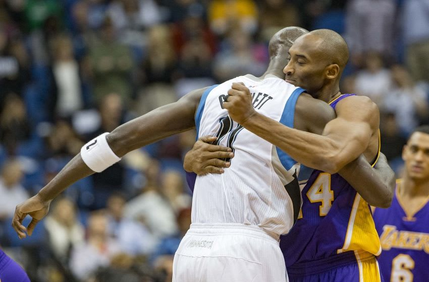 Dec 9, 2015; Minneapolis, MN, USA; Los Angeles Lakers forward Kobe Bryant (24) hugs Minnesota Timberwolves forward Kevin Garnett (21) before the game at Target Center. Mandatory Credit: Jesse Johnson-USA TODAY Sports