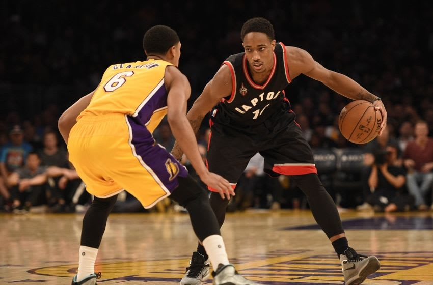 Nov 20, 2015; Los Angeles, CA, USA; Toronto Raptors guard DeMar DeRozan (10) moves the ball defended by Los Angeles Lakers guard Jordan Clarkson (6) during the fourth quarter at Staples Center. The Toronto Raptors won 102-91. Mandatory Credit: Kelvin Kuo-USA TODAY Sports