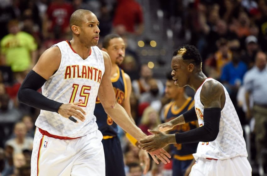 May 8, 2016; Atlanta, GA, USA; Atlanta Hawks center Al Horford (15) reacts with guard Dennis Schroder (17) after making a three point basket against the Cleveland Cavaliers during the second half in game four of the second round of the NBA Playoffs at Philips Arena. The Cavaliers defeated the Hawks 100-99. Mandatory Credit: Dale Zanine-USA TODAY Sports