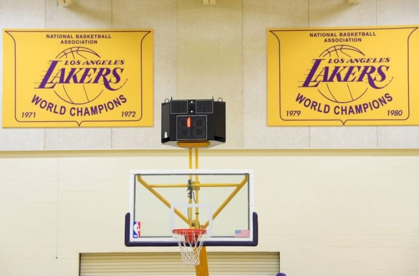 Mar 24, 2015; El Segundo, CA, USA; General view of Los Angeles Lakers 1971-72 and 1979-80 NBA championship banners and backboard and rim at the Toyota Sports Center. Mandatory Credit: Kirby Lee-USA TODAY Sports