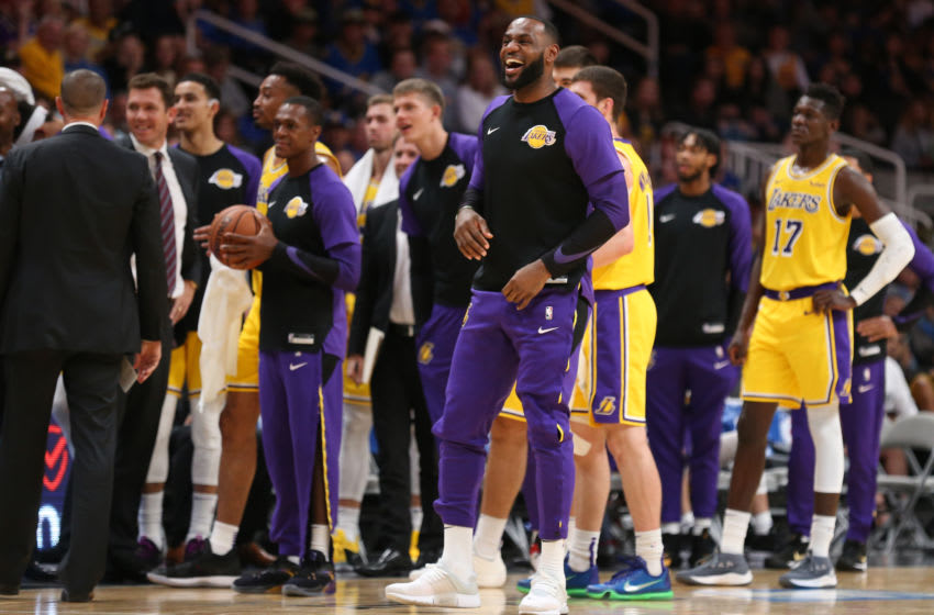 SAN JOSE, CA - OCTOBER 12: Los Angeles Lakers' LeBron James (23) smiles as he jokes with Golden State Warriors players during a break in the action in their NBA preseason game at SAP Center in San Jose, Calif., on Friday, Oct. 12, 2018. (Anda Chu/Digital First Media/The Mercury News via Getty Images)