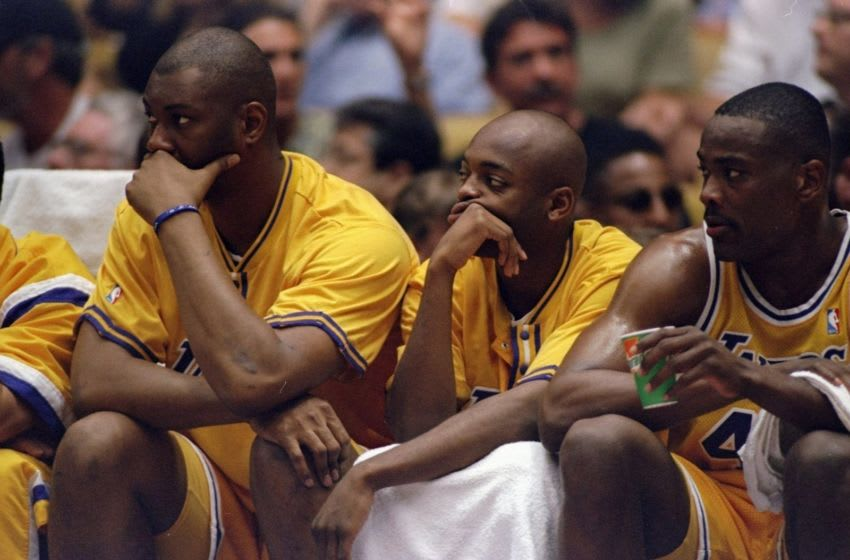 22 May 1998: (L-R) Elden Campbell #41, Nick Van Exel #9 and Corie Blount #43 of the Los Angeles Lakers look on during game three of the Western Conference Finals against the Utah Jazz at the Great Western Forum in Inglewood, California. The Jazz defeated