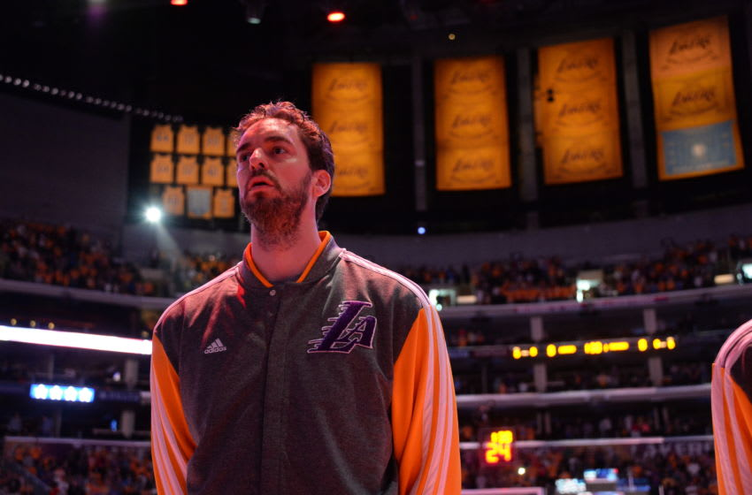 LOS ANGELES, CA - MARCH 9: Pau Gasol #16 of the Los Angeles Lakers stands in observance of the national anthem before a game against the Oklahoma City Thunder at STAPLES Center on March 9, 2014 in Los Angeles, California. NOTE TO USER: User expressly acknowledges and agrees that, by downloading and/or using this Photograph, user is consenting to the terms and conditions of the Getty Images License Agreement. Mandatory Copyright Notice: Copyright 2014 NBAE (Photo by Andrew D. Bernstein/NBAE via Getty Images)