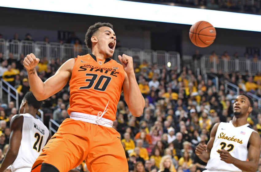 WICHITA, KS - DECEMBER 17: Guard Jeffrey Carroll #30 of the Oklahoma State Cowboys reacts after a dunk against the Wichita State Shockers during the first half on December 17, 2016 at INTRUST Bank Arena in Wichita, Kansas. (Photo by Peter G. Aiken/Getty Images)