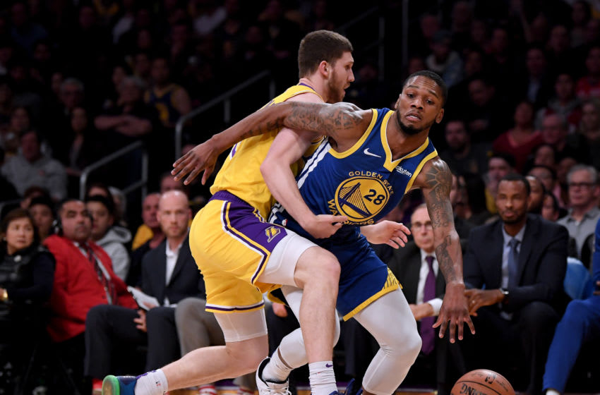 LOS ANGELES, CALIFORNIA - JANUARY 21: Alfonzo McKinnie #28 of the Golden State Warriors gets fouled by Sviatoslav Mykhailiuk #10 of the Los Angeles Lakers during a 130-111 win at Staples Center on January 21, 2019 in Los Angeles, California. NOTE TO USER: User expressly acknowledges and agrees that, by downloading and or using this photograph, User is consenting to the terms and conditions of the Getty Images License Agreement. (Photo by Harry How/Getty Images)