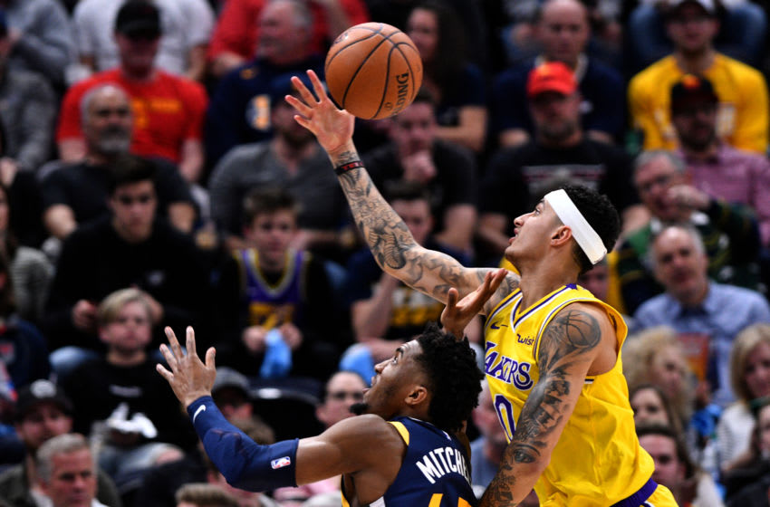 SALT LAKE CITY, UT - MARCH 27: Kyle Kuzma #0 of the Los Angeles Lakers goes for the rebound over Donovan Mitchell #45 of the Utah Jazz in the first half of a NBA game at Vivint Smart Home Arena on March 27, 2019 in Salt Lake City, Utah. NOTE TO USER: User expressly acknowledges and agrees that, by downloading and or using this photograph, User is consenting to the terms and conditions of the Getty Images License Agreement. (Photo by Gene Sweeney Jr./Getty Images)