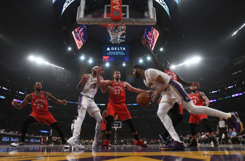 LOS ANGELES, CALIFORNIA - NOVEMBER 10: Anthony Davis #3 of the Los Angeles Lakers dribbles under the basket as he is surrounded by Marc Gasol #33 and Pascal Siakam #43 of the Toronto Raptors during a 113-104 Raptors win at Staples Center on November 10, 2019 in Los Angeles, California. NOTE TO USER: User expressly acknowledges and agrees that, by downloading and/or using this photograph, user is consenting to the terms and conditions of the Getty Images License Agreement. (Photo by Harry How/Getty Images)