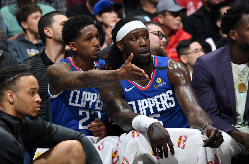 LOS ANGELES, CA - JANUARY 4: Lou Williams #23 and Montrezl Harrell #5 of the LA Clippers share a conversation during the game against the Memphis Grizzlies on January 4, 2020 at STAPLES Center in Los Angeles, California. NOTE TO USER: User expressly acknowledges and agrees that, by downloading and/or using this Photograph, user is consenting to the terms and conditions of the Getty Images License Agreement. Mandatory Copyright Notice: Copyright 2020 NBAE (Photo by Andrew D. Bernstein/NBAE via Getty Images)