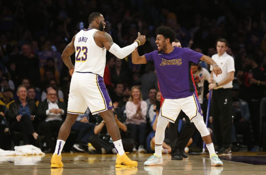 LOS ANGELES, CALIFORNIA - DECEMBER 08: LeBron James #23 of the Los Angeles Lakers celebrates a three-pointer Quinn Cook #2 of the Los Angeles Lakers during the fourth quarter against the Minnesota Timberwolves with at Staples Center on December 08, 2019 in Los Angeles, California. NOTE TO USER: User expressly acknowledges and agrees that, by downloading and or using this photograph, User is consenting to the terms and conditions of the Getty Images License Agreement. (Photo by Katharine Lotze/Getty Images)