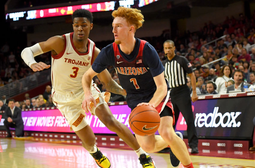 LOS ANGELES, CA - FEBRUARY 27: Elijah Weaver #3 of the USC Trojans guards Nico Mannion #1 of the Arizona Wildcats as he drives to the basket in the first half of the game at Galen Center on February 27, 2020 in Los Angeles, California. (Photo by Jayne Kamin-Oncea/Getty Images)