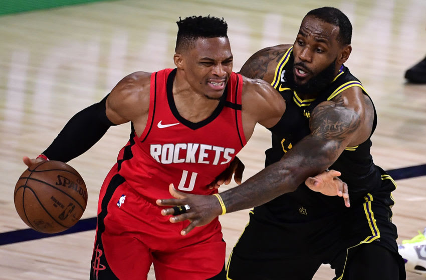 LAKE BUENA VISTA, FLORIDA - SEPTEMBER 06: Russell Westbrook #0 of the Houston Rockets drives the ball against LeBron James #23 of the Los Angeles Lakers during the fourth quarter in Game Two of the Western Conference Second Round during the 2020 NBA Playoffs at AdventHealth Arena at the ESPN Wide World Of Sports Complex on September 06, 2020 in Lake Buena Vista, Florida. NOTE TO USER: User expressly acknowledges and agrees that, by downloading and or using this photograph, User is consenting to the terms and conditions of the Getty Images License Agreement. (Photo by Douglas P. DeFelice/Getty Images)