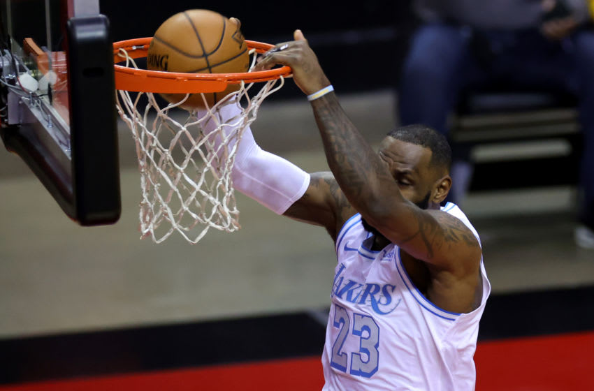 HOUSTON, TEXAS - JANUARY 10: LeBron James #23 of the Los Angeles Lakers dunks the ball during the first quarter of a game against the Houston Rockets at Toyota Center on January 10, 2021 in Houston, Texas. NOTE TO USER: User expressly acknowledges and agrees that, by downloading and or using this photograph, User is consenting to the terms and conditions of the Getty Images License Agreement. (Photo by Carmen Mandato/Getty Images)