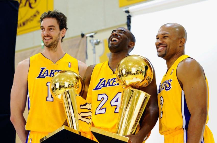 EL SEGUNDO, CA - SEPTEMBER 25: Kobe Bryant #24 of the Los Angeles Lakers laughs as he holds two NBA Finals Larry O'Brien Championship Trophy's as he poses for a photograph with teammates Pau Gasol #16 and Derek Fisher #2 during Media Day at the Toyota Center on September 25, 2010 in El Segundo, California. NOTE TO USER: User expressly acknowledges and agrees that, by downloading and/or using this Photograph, user is consenting to the terms and conditions of the Getty Images License Agreement. (Photo by Kevork Djansezian/Getty Images)