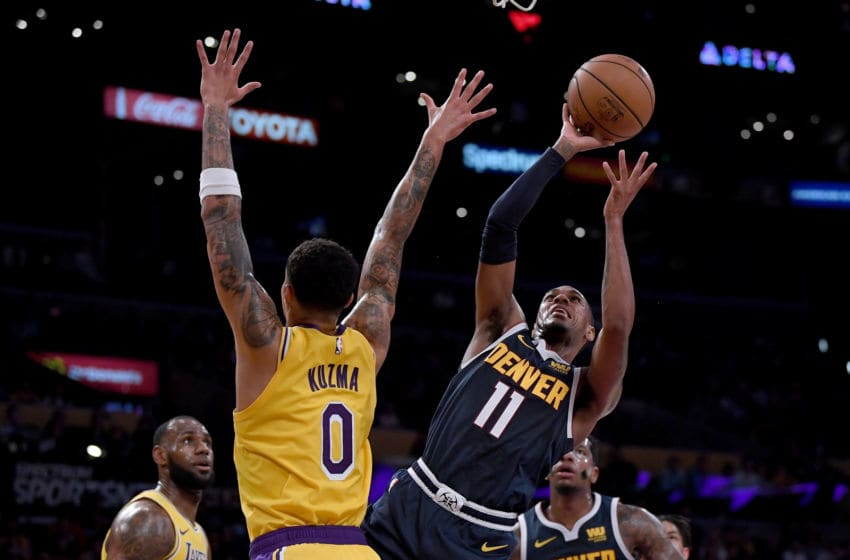 LOS ANGELES, CA - OCTOBER 02: Monte Morris #11 of the Denver Nuggets attempts a shot in front of Kyle Kuzma #0 of the Los Angeles Lakers during a preseason game at Staples Center on October 2, 2018 in Los Angeles, California. (Photo by Harry How/Getty Images)