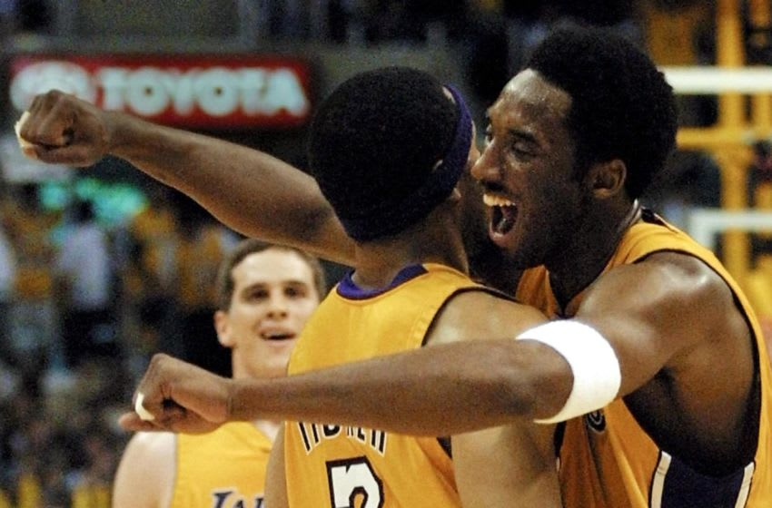 LOS ANGELES, UNITED STATES: Kobe Bryant (R) of the Los Angeles Lakers celebrates with Derek Fisher(L) during game four of their Western Conference Finals against the San Antonio Spurs 27 May 2001 at the Staples Center in Los Angeles, CA. The Lakers beat the Spurs 111-82 to sweep the best-of-seven series 4-0. AFP PHOTO/Mike NELSON (Photo credit should read MIKE NELSON/AFP via Getty Images)