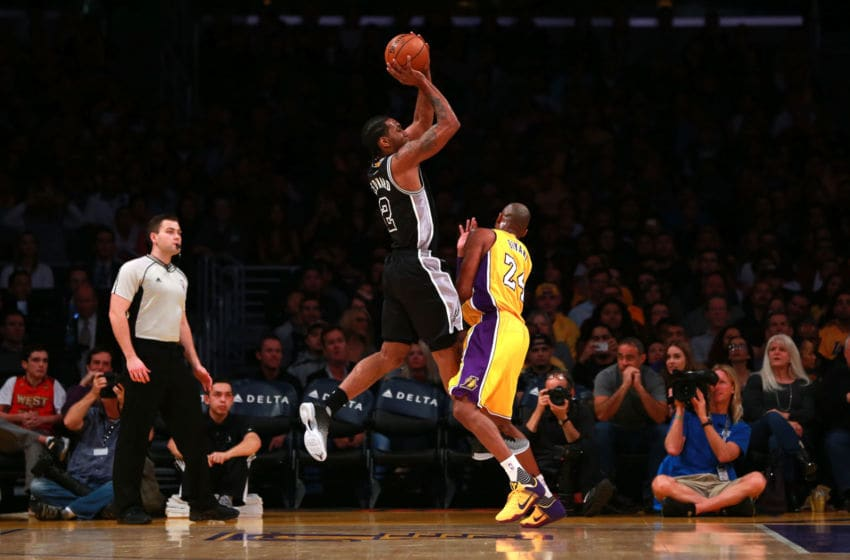 LOS ANGELES, CA - JANUARY 22: Kawhi Leonard #2 of the San Antonio Spurs draws a foul on Kobe Bryant #24 of the Los Angeles Lakers during the NBA game at Staples Center on January 22, 2016 in Los Angeles, California. NOTE TO USER: User expressly acknowledges and agrees that, by downloading and or using this photograph, User is consenting to the terms and conditions of the Getty Images License Agreement. (Photo by Victor Decolongon/Getty Images)