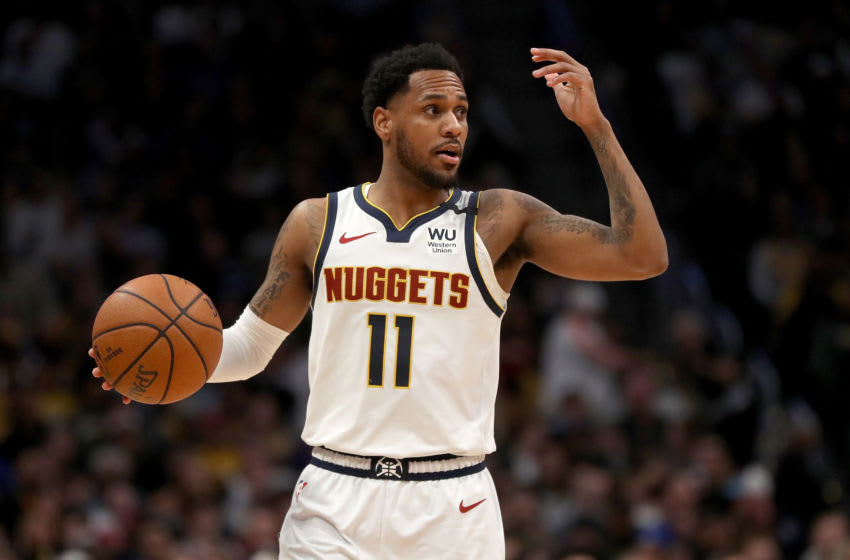 DENVER, COLORADO - FEBRUARY 12: Monte Morris #11 of the Denver Nuggets brings the ball down the court against the Los Angeles Lakers in the third quarter at Pepsi Center on February 12, 2020 in Denver, Colorado. NOTE TO USER: User expressly acknowledges and agrees that, by downloading and or using this photograph, User is consenting to the terms and conditions of the Getty Images License Agreement. (Photo by Matthew Stockman/Getty Images)