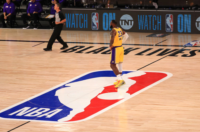 LAKE BUENA VISTA, FLORIDA - JULY 30: LeBron James #23 of the Los Angeles Lakers stands on the NBA logo against the LA Clippers during the second quarter of the game at The Arena at ESPN Wide World Of Sports Complex on July 30, 2020 in Lake Buena Vista, Florida. NOTE TO USER: User expressly acknowledges and agrees that, by downloading and or using this photograph, User is consenting to the terms and conditions of the Getty Images License Agreement. (Photo by Mike Ehrmann/Getty Images)