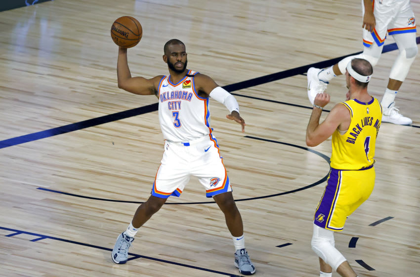 LAKE BUENA VISTA, FLORIDA - AUGUST 05: Chris Paul #3 of the Oklahoma City Thunder handles the ball on offense against the Los Angeles Lakers during the first quarter at HP Field House at ESPN Wide World Of Sports Complex on August 05, 2020 in Lake Buena Vista, Florida. NOTE TO USER: User expressly acknowledges and agrees that, by downloading and or using this photograph, User is consenting to the terms and conditions of the Getty Images License Agreement. (Photo by Kevin C. Cox/Getty Images)
