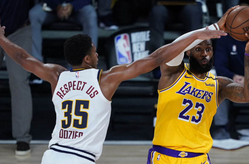 LAKE BUENA VISTA, FLORIDA - AUGUST 10: LeBron James #23 of the Los Angeles Lakers looks to pass while pressured by PJ Dozier #35 of the Denver Nuggets during the second half at The Arena at ESPN Wide World Of Sports Complex on August 10, 2020 in Lake Buena Vista, Florida. NOTE TO USER: User expressly acknowledges and agrees that, by downloading and or using this photograph, User is consenting to the terms and conditions of the Getty Images License Agreement. (Photo by Ashley Landis-Pool/Getty Images)