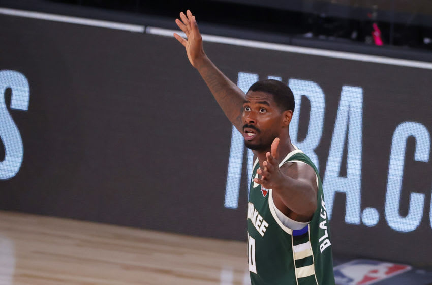 LAKE BUENA VISTA, FLORIDA - AUGUST 08: Marvin Williams #20 of the Milwaukee Bucks reacts to a call during the fourth quarter against the Dallas Mavericks at The Arena at ESPN Wide World Of Sports Complex on August 08, 2020 in Lake Buena Vista, Florida. NOTE TO USER: User expressly acknowledges and agrees that, by downloading and or using this photograph, User is consenting to the terms and conditions of the Getty Images License Agreement. (Photo by Kevin C. Cox/Getty Images)