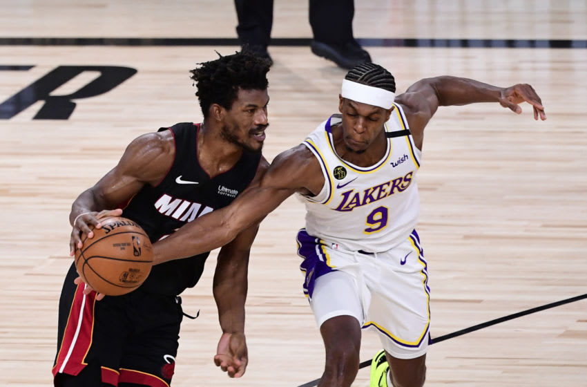LAKE BUENA VISTA, FLORIDA - OCTOBER 04: Jimmy Butler #22 of the Miami Heat dribbles against Rajon Rondo #9 of the Los Angeles Lakers during the second half in Game Three of the 2020 NBA Finals at AdventHealth Arena at ESPN Wide World Of Sports Complex on October 04, 2020 in Lake Buena Vista, Florida. NOTE TO USER: User expressly acknowledges and agrees that, by downloading and or using this photograph, User is consenting to the terms and conditions of the Getty Images License Agreement. (Photo by Douglas P. DeFelice/Getty Images)