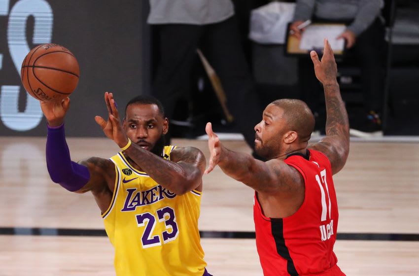 LAKE BUENA VISTA, FLORIDA - SEPTEMBER 10: LeBron James #23 of the Los Angeles Lakers drives the ball against P.J. Tucker #17 of the Houston Rockets during the first quarter in Game Four of the Western Conference Second Round during the 2020 NBA Playoffs at AdventHealth Arena at the ESPN Wide World Of Sports Complex on September 10, 2020 in Lake Buena Vista, Florida. NOTE TO USER: User expressly acknowledges and agrees that, by downloading and or using this photograph, User is consenting to the terms and conditions of the Getty Images License Agreement. (Photo by Michael Reaves/Getty Images)