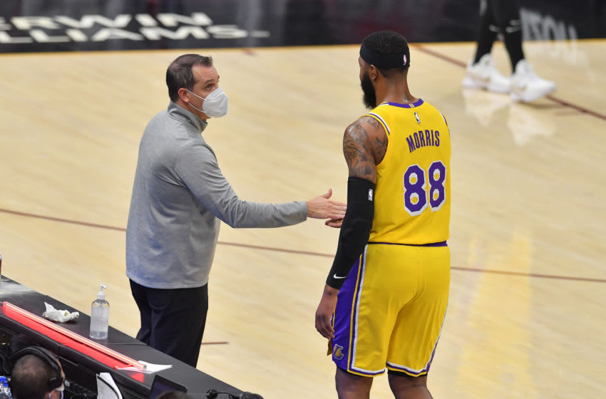 CLEVELAND, OHIO - JANUARY 25: Head coach Frank Vogel congratulates Markieff Morris #88 of the Los Angeles Lakers as he leaves the game during the second quarter against the Cleveland Cavaliers at Rocket Mortgage Fieldhouse on January 25, 2021 in Cleveland, Ohio. NOTE TO USER: User expressly acknowledges and agrees that, by downloading and/or using this photograph, user is consenting to the terms and conditions of the Getty Images License Agreement. (Photo by Jason Miller/Getty Images)