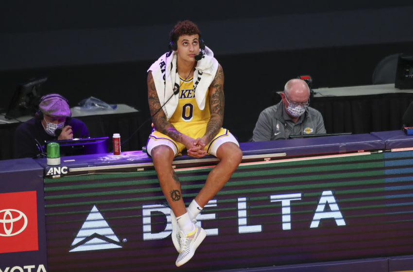 LOS ANGELES, CALIFORNIA - FEBRUARY 10: Kyle Kuzma #0 of the Los Angeles Lakers is interviewed after the game against the Oklahoma City Thunder at Staples Center on February 10, 2021 in Los Angeles, California. NOTE TO USER: User expressly acknowledges and agrees that, by downloading and or using this photograph, User is consenting to the terms and conditions of the Getty Images License Agreement. (Photo by Meg Oliphant/Getty Images)