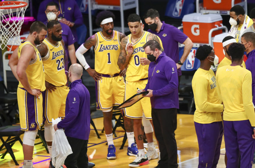 LOS ANGELES, CALIFORNIA - FEBRUARY 20: Los Angeles Lakers head coach Frank Vogel talks with the team during a time out against the Miami Heat at Staples Center on February 20, 2021 in Los Angeles, California. NOTE TO USER: User expressly acknowledges and agrees that, by downloading and or using this photograph, User is consenting to the terms and conditions of the Getty Images License Agreement. (Photo by Meg Oliphant/Getty Images)