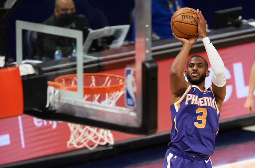 MINNEAPOLIS, MINNESOTA - FEBRUARY 28: Chris Paul #3 of the Phoenix Suns shoots the ball against the Minnesota Timberwolves during the fourth quarter of the game at Target Center on February 28, 2021 in Minneapolis, Minnesota. The Suns defeated the Timberwolves 118-99. NOTE TO USER: User expressly acknowledges and agrees that, by downloading and or using this Photograph, user is consenting to the terms and conditions of the Getty Images License Agreement (Photo by Hannah Foslien/Getty Images)