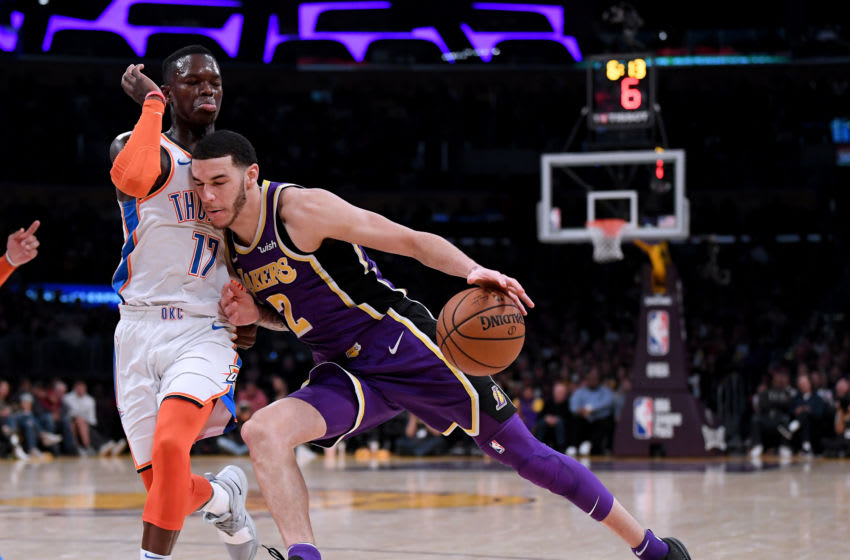 LOS ANGELES, CALIFORNIA - JANUARY 02: Lonzo Ball #2 of the Los Angeles Lakers drives on Dennis Schroder #17 of the Oklahoma City Thunder during a 107-100 Thunder win at Staples Center on January 02, 2019 in Los Angeles, California. NOTE TO USER: User expressly acknowledges and agrees that, by downloading and or using this photograph, User is consenting to the terms and conditions of the Getty Images License Agreement. (Photo by Harry How/Getty Images)