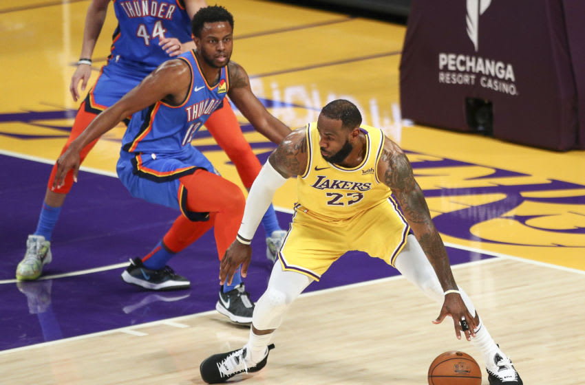 LOS ANGELES, CALIFORNIA - FEBRUARY 10: LeBron James #23 of the Los Angeles Lakers handles the ball defended by Darius Miller #12 of the Oklahoma City Thunder at Staples Center on February 10, 2021 in Los Angeles, California. NOTE TO USER: User expressly acknowledges and agrees that, by downloading and or using this photograph, User is consenting to the terms and conditions of the Getty Images License Agreement. (Photo by Meg Oliphant/Getty Images)